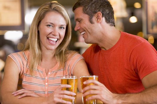Couple having beer together