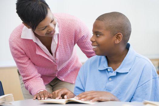 Teacher helping elementary school pupil