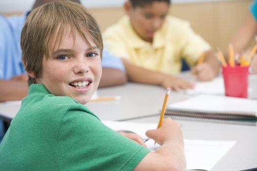 Elementary school pupil writing