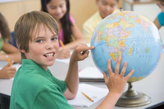 Elementary school pupil with globe