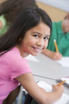 Female pupil in elementary school classroom