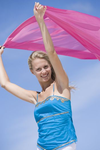 Young woman holding pink wrap