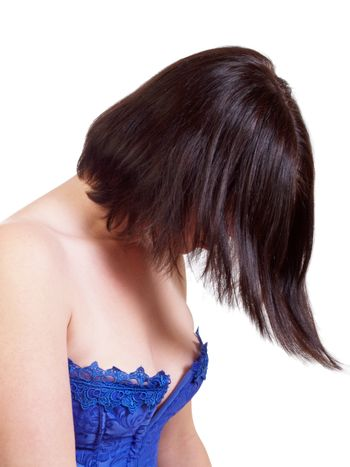 Hair hiding face portrait of woman in blue corset