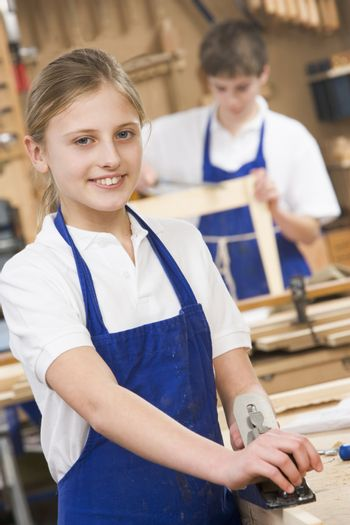 Female student learning woodworking