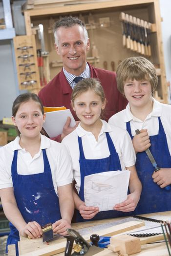 Students in woodworking class with teacher