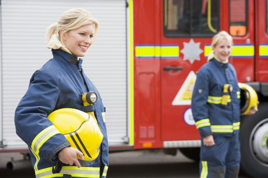 Firewoman standing by fire engine