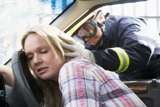 Fireman helping a woman after she got in an accident