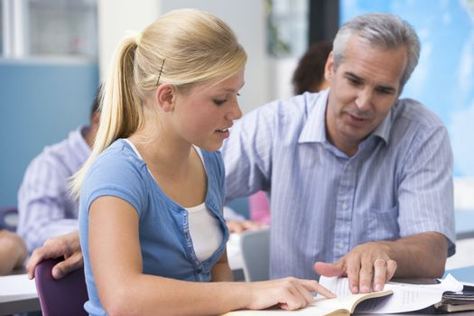 Teacher giving personal instruction to female student