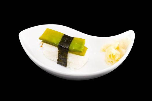 a white plate with a piece of sushi