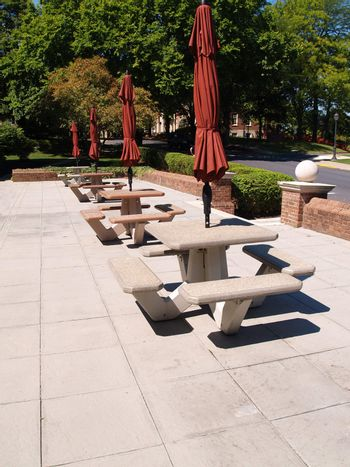 empty tables in an outdoor eating area