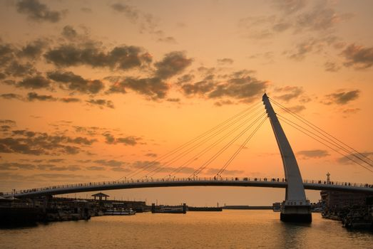 Sunset landscape with golden river and bridge silhouette in Taiwan.