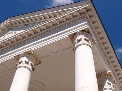 upward view of two white large columns for a building