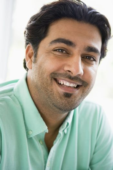 Man indoors smiling (high key)