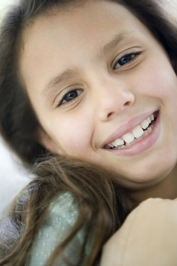 Young girl indoors smiling (high key)