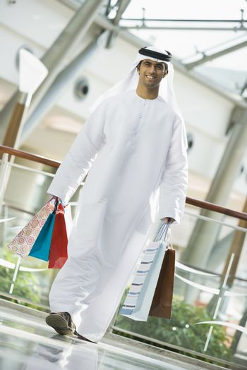 Man walking in mall smiling (selective focus)