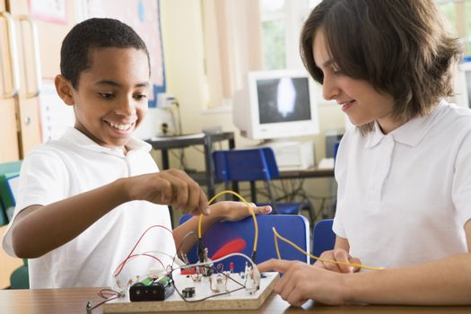 Students in class with electronic projects
