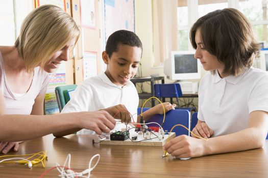 Students and teacher in class with electronic project