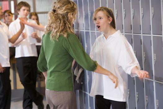 Female teacher reprimanding a female student
