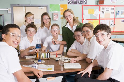 Students receiving chemistry lesson in classroom