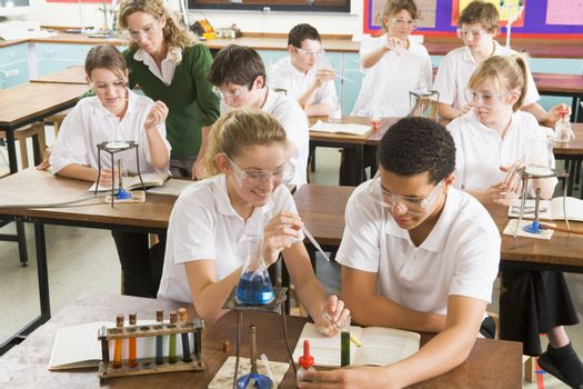 Students performing science experiments in classroom