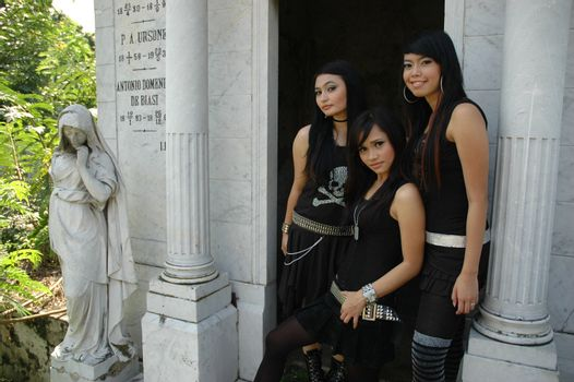 three asian ladies wearing nice and fashionable gothic suit