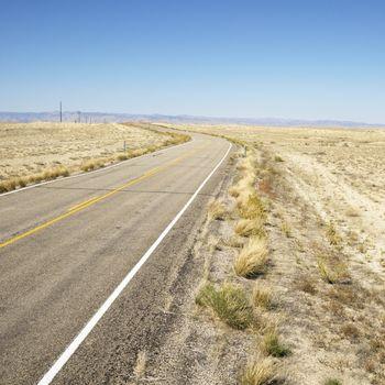 Road through barren landscape.