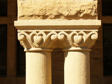 Two column supports with detail showing carvings and texture