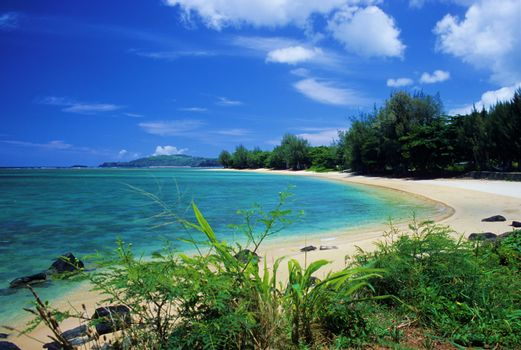 The calm, shallow waters of Anini Beach are perfect for snorkeling. Located on the island of Kauai, Hawaii.