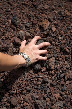 woman take volcanic stones