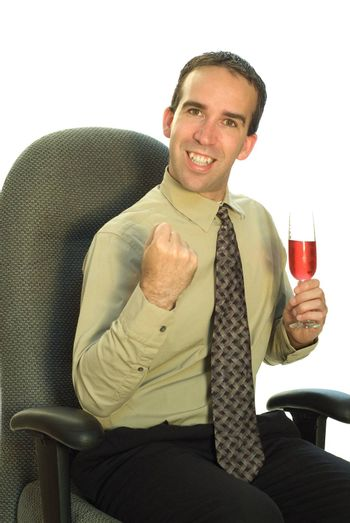 A young businessman looking excited and holding a glass of wine