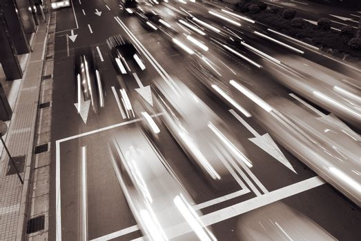 Cars movement with light in the modern city night.