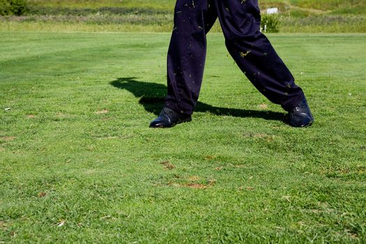 A golfer who has just swung at a golf ball