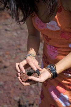 volcanic stones on her hands