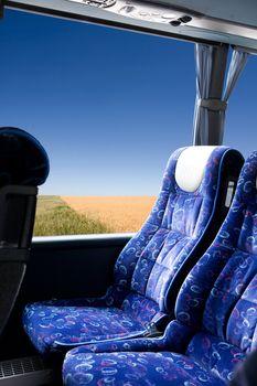 A prairie view from a bus