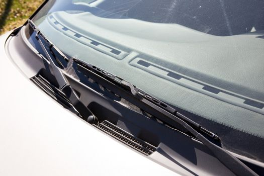 A windshield wiper detail on a car