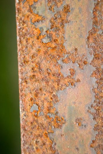 An orange and brown rust background texture image.