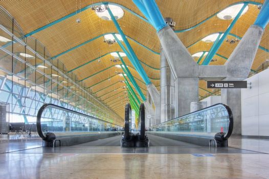 Walkway in departure hall - Airport Madrid Barajas - HDR image
