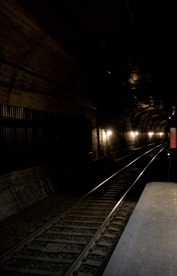 A train tunnel into the darkness