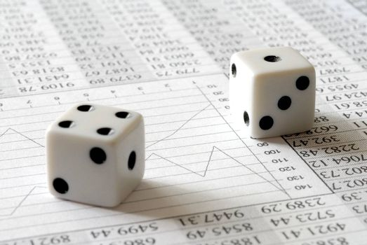 Two dice on paper sheet with numbers and chart