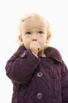 Toddler sucking thumb.