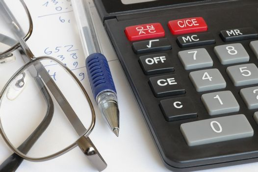 Calculator, pen, glasses and some calculations
