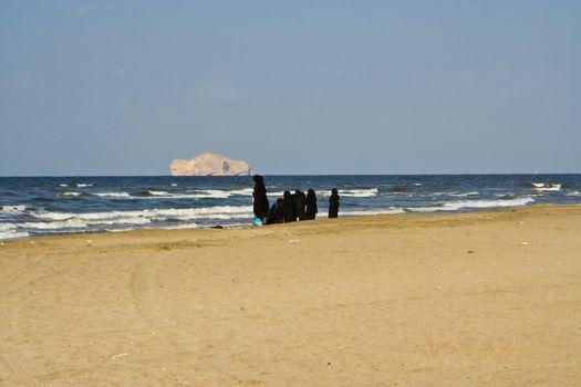 Arabian women on a beach