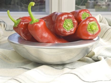 fresh and red pepper in a silver bowl
