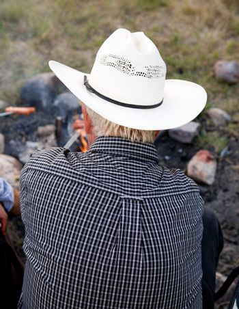 A cowboy viewed from the back