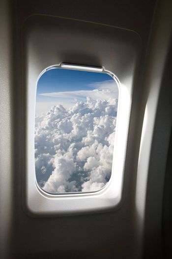 A view of clouds from an airplane window.
