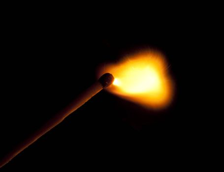 match just ignited isolated on black