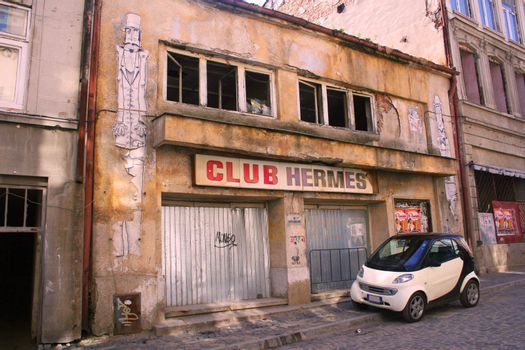 Graffiti covered abandoned club in Bucharest old town