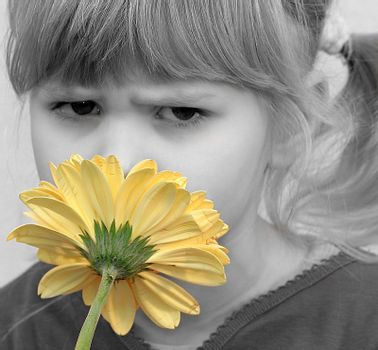 child, a flower