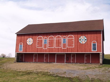 red barn with Pennsylvania dutch hex signs