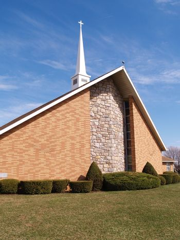 modern brick church with white steeple